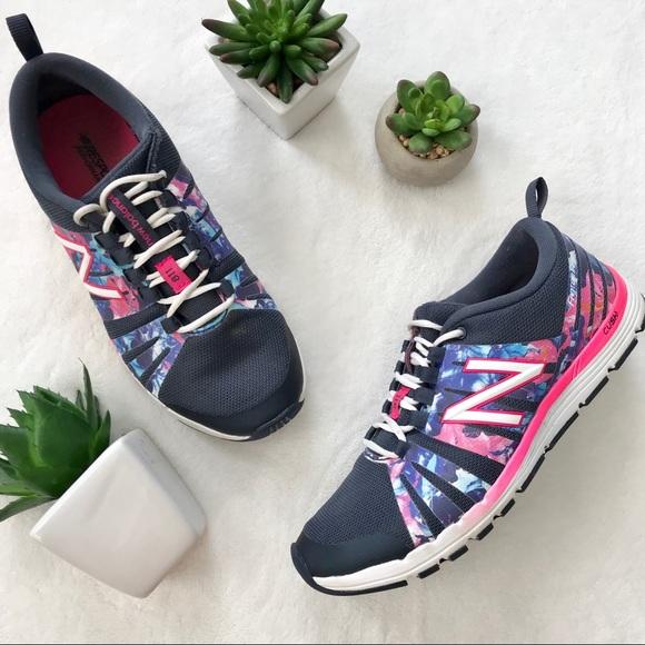 1d4d8ee12b6 New Balance 811 athletic tennis shoes navy pink. M 5b7998417c979d3ca1d1c994